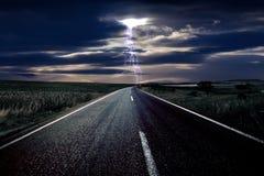 Relâmpago e a estrada Fotografia de Stock