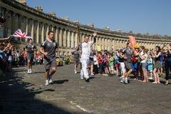 Relé de tocha olímpico 2012, banho, Reino Unido. Fotografia de Stock