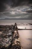 Relíquia do tempo de guerra em uma praia de Galês Fotos de Stock