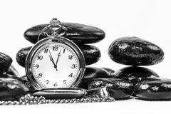 Relógio de bolso e pedras empilhadas Fotos de Stock Royalty Free