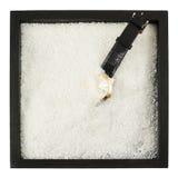 Relógio de pulso em uma composição da caixa de areia Fotografia de Stock