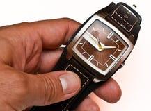 Relógio de pulso na mão Fotografia de Stock