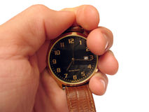 Relógio de pulso na mão isolada Imagem de Stock
