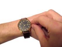 Relógio de pulso na mão isolada Fotos de Stock Royalty Free