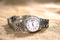 Relógio de pulso no saco fotografia de stock