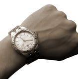 Relógio de pulso no tom isolado mão Fotos de Stock