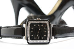 Relógio de senhoras e sapatas dos saltos elevados Fotografia de Stock Royalty Free