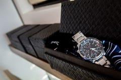 Relógio dentro da caixa Fotografia de Stock Royalty Free