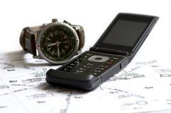 Relógio e mapa do telefone Fotografia de Stock Royalty Free