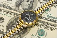 Relógio em dólares Fotos de Stock Royalty Free