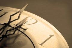 Relógio no sepia da meia-noite tonificado fotografia de stock royalty free