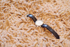 Relógio no tapete Fotografia de Stock Royalty Free