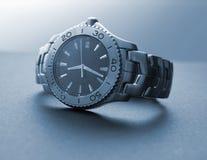 Relógio viril imagem de stock
