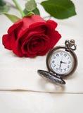 Relógios e Rosa de bolso Imagem de Stock Royalty Free