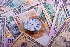 Relógios retros no dinheiro Imagem de Stock Royalty Free