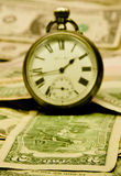 Relógios retros no dinheiro de $ Imagens de Stock Royalty Free