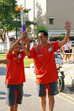 Relé da tocha dos Jogos Olímpicos 2010 da juventude Foto de Stock