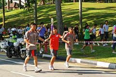 Relé da tocha dos Jogos Olímpicos 2010 da juventude Imagem de Stock