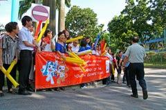 Relè della torcia dei Giochi Olimpici 2010 della gioventù Fotografie Stock