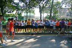 Relè della torcia dei Giochi Olimpici 2010 della gioventù Immagini Stock Libere da Diritti