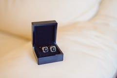 Relações de luva na caixa azul Imagem de Stock Royalty Free