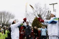 Relais de la antorcha de 2010 Juegos Olímpicos de Invierno Imagen de archivo libre de regalías