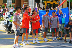 Relais de la antorcha de los Juegos Olímpicos 2010 de la juventud Imagen de archivo libre de regalías