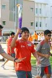Relais de la antorcha de los Juegos Olímpicos 2010 de la juventud Imágenes de archivo libres de regalías