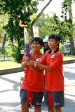 Relais de la antorcha de los Juegos Olímpicos 2010 de la juventud Fotografía de archivo
