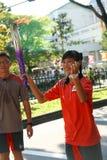 Relais de torche des Jeux Olympiques 2010 de la jeunesse Photo libre de droits