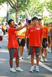 Relais de torche des Jeux Olympiques 2010 de la jeunesse Photographie stock libre de droits