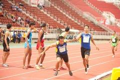 Relais in Thailand Open-athletischer Meisterschaft 2013. Stockbild