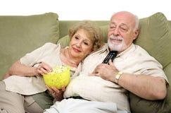 Relajación con la televisión Foto de archivo libre de regalías
