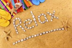 Relaje la escritura de la playa Imagen de archivo libre de regalías