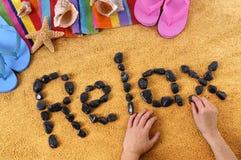 Relaje la escritura de la playa Fotografía de archivo libre de regalías