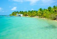 Relaksować przy Plażowym domem Zdjęcia Royalty Free