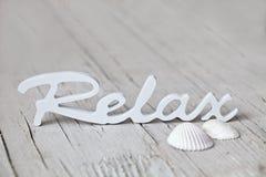 relaksuje drewnianego słowo Zdjęcie Stock