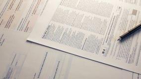 Relatório do imposto e formulários de imposto filme