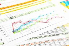 Relatórios comerciais no gráfico multicolorido Imagem de Stock Royalty Free