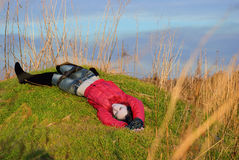 Related corpse of a young girl lies on a hill Royalty Free Stock Photo