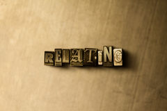 RELATING - close-up of grungy vintage typeset word on metal backdrop Stock Image