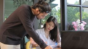 Relation of freelance man and woman working together in home office stock video