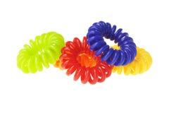 Relations étroites élastiques spiralées colorées de cheveu Photographie stock