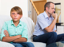 Relations of arguing unhappy son and dad Stock Images