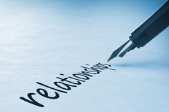 Relations d'écriture de stylo-plume photographie stock libre de droits