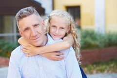 Relations. Dad. Daughter. Heat. Family. Love. Gentle embrace. Smiling Father and young pretty Daughter. Heat. Family Love. Gentle embrace Stock Images