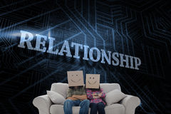 Relationship against futuristic black and blue background Stock Images