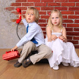 Relationship. Beautiful girl and boy with phone. Stock Photo