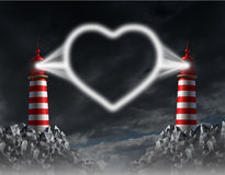 Relationship Communication. And love guide concept with two lighthouses shining a beacon light shaped as a romantic heart icon of togetherness on a night sky Royalty Free Stock Photography