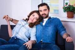 Relationship concept - portrait of cute young couple sitting in Royalty Free Stock Photo